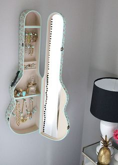 """I found these cool ideas to use old guitars and cases on Pinterest! Guitar Wine Rack: """"I made this out of an old, broken guitar. Didn't cost a penny. """"Google"""" swirl images and print them out. Tape stencils on the guitar. Drill holes along stencil. Remove paper. Use a jig saw to open top about 1/3rd …"""
