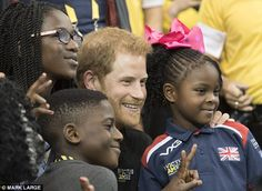 Strike a pose! Harry happily snapped pictures with the families of Team UK during the fina...