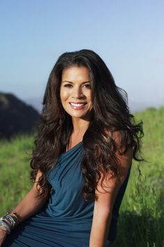 dina eastwood! she's so gorgeous & exotic - her parents are white and black/asian