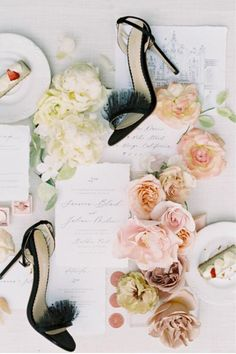 """From the editorial """"A Lavish Ombre Floral Runner and a Bold Color Palette at Balboa Park."""" One of our favorite shots from this stunning wedding shoot! We just love the soft petals and black wedding shoes!  Photography: @iamlatreuophoto  #blackweddingshoes #weddinginvitations #weddingflatlay #weddinginspiration"""
