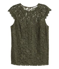Khaki green. Lace top with cap sleeves and opening at back of neck with button. Partly lined in jersey.