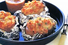 A baked potato stuffed with ham and parmesan cheese makes an easy and tasty meal.