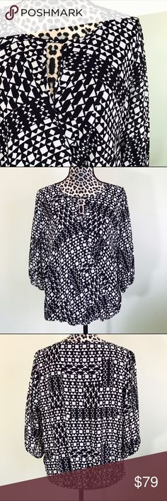 💕Vince Camuto faux wrap shirt Beautiful black and white patterned shirt with faux wrap front. Elastic at wrists and waist. Shell and lining are 100% polyester. Vince Camuto Tops Blouses