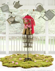 april showers! Antique dress form decorated with pink flowers and scarf. This whole display is not complicated but really a pretty eye catching visual.