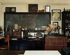 roman and williams... triple like.  SIgh... love old laboratory/school/science-y stuff.
