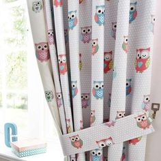 With embroidered owl panels on the inside edges, these pencil pleat curtains feature a colourful owl print on a dotted background. Available in a choice of drop...