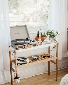 Have some empty space in your living room? This old school idea is perfect to complete your home decor. Add a record player for that vintage touch.