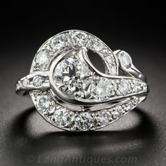 A fanciful free-form swirl is packed with 2.15 carats of glittering white diamonds in this wonderful, one-of-a-kind cocktail (or right hand) ring, dating back to the middle of the last century. Crafted in bright white gold, currently ring size 5.