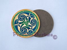 A set of 4 decorative coasters with Celtic triskele design from the Book of Kells. Coloration and background by me. The triskele design is displayed in vibrant colors and is very striking! Hardboard with a glossy top. 3 1/2 round. To clean simply wipe with a damp cloth. Protect your furniture with these adorable coasters.  Made using a sublimation printing process.  Can personalize or make custom coasters, send me a message and well talk :)
