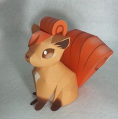 Pokemon Vulpix Papercraft-Ive actually made this. Its simple and small, but ADORABLE :)  (This is the one in the bottle)