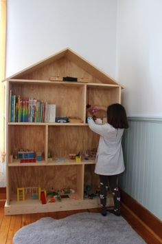 Another picture of a doll house style book shelf.  Would paint and tweak a bit, but simple cuts.