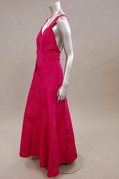 A Schiaparelli shocking pink moiré evening gown, late 1930s, printed label `Schiaparelli', 21 Place Vendome, Paris', Provenance: Baroness Maria Ursula von Storher. Sideway
