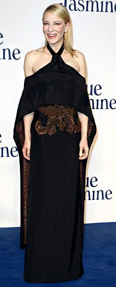 Cate Blanchett hit the London premiere of her new film, Blue Jasmine, wearing a black halter gown by Givenchy Haute Couture with attached cape.