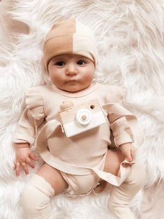 This cute unique camel & champagne beanie is great to complete any outfit! Each piece is flawlessly handmade, stylish for you or your little one and makes a great gift that anyone can be proud to give to a lucky mom and baby. #uniquebabyclothes #cutekidshats #3in1beanie #oneofakindgifts #babyshowergiftidea