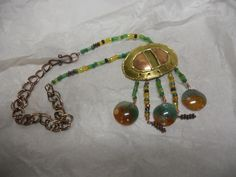 Necklace with vintage copper piece and agate.  Visit on Facebook.
