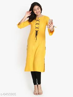 Kurtis & Kurtas Women's Solid Yellow Rayon Slub Kurti Fabric: Rayon Slub Sleeves: 3/4 Sleeves Are Included Size:  M - 38 in L - 40 in XL - 42 inXXL - 44 in Length: Up To 46 in Type: Stitched Description: It Has 1 Piece Of Women's Kurti Work: Embroidered & Tassel Work Country of Origin: India Sizes Available: M, L, XL, XXL   Catalog Rating: ★4.1 (489)  Catalog Name: Women'S Printed Cotton Kurtis CatalogID_398614 C74-SC1001 Code: 093-6400905-0201