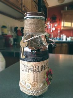 Repurposing a Starbucks jar by decorating it and using it for spare change.