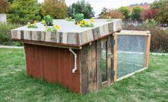 Planter coop: This coop design features a roof that doubles as a flower garden! | 5 Fun Chicken Coop Designs | Living the Country Life | http://www.livingthecountrylife.com/animals/chickens-poultry/5-fun-chicken-coop-designs