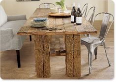 Wood table made to look rustic. I have also seen old restored doors that have been made into the dining room table...incredible!!! Looks great with mix and match chairs and/or benches alongside upholstered statement chairs