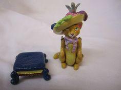 Hantel Cat in Hat on Stool