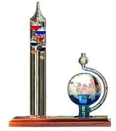 Chaney Instrument Galileo Thermometer with Glass Globe Barometer. ( I have the Thermometer, just gotta get the Barometer now! Galileo Thermometer, Digital Thermometer, Binocular Craft, Weather Instruments, World Globes, Coups, Accent Pieces, Wind Chimes, Just In Case