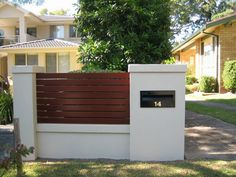 letterbox built into brick fence