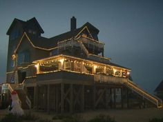 """When decorating is finished, the Hatteras Island house made famous in """"The Nights of Rondathe"""" movie will have about 10,000 Christmas lights."""