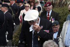 Emotional: Douglas Turtle, 91, from the Isle of Wight wipes away a tear during the service of commemeration at the D-Day Stone on the Southsea seafront in Portsmouth