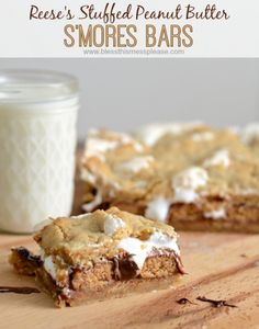 Reese's Stuffed Peanut Butter S'mores Bars   peanut buttery graham cracker infused cookie-like crust, Reese's cups, chocolate, and marshmallow all melted together into one incredible dessert