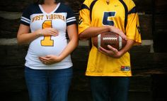 Unique football maternity photo with daddy. Belly detail shot with sports team. Fall maternity ideas. Belly and football pose. Creative ways to invoke husband in pregnancy pictures. WVU West Virginia university mountaineer football fan maternity shoot. Lauren Davidson photography. #LaurenDavidsonPhotography