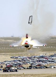 Thunderbird crashes in huge fireball at airshow - The pilot, Capt. Chris Strickland, who ejected at literally the last second before his F-16 hit the ground, earned a huge ovation from the crowd as he stood briefly after parachuting to earth, just missing the hundreds of yards of smoke and flame that his aircraft and its 6800 pounds of jet fuel created after crashing in front of the control tower. Then he collapsed, just as rescue crews were arriving.