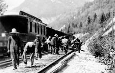 Archival image of Chinese-Canadian CPR workers laying track in 1924.