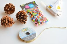 These pom pom and pinecone ornaments are SO EASY! They're a great craft for both kids and adults and they end up looking surprisingly beautiful! Diy Christmas Gifts For Kids, Christmas Projects, Holiday Crafts, Holiday Fun, Christmas Ornaments, Pinecone Ornaments, Cute Crafts, Craft Stick Crafts, Craft Gifts
