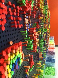 Colored golf tees in peg board- kind like a light bright without the light.