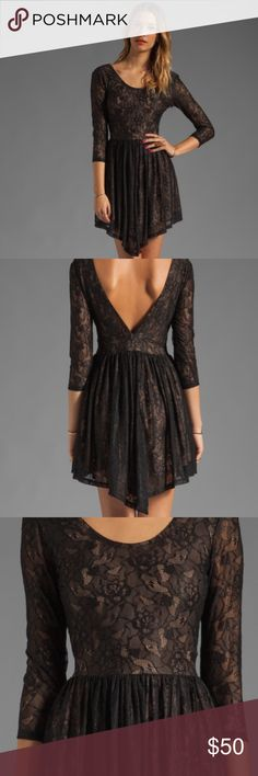 """Lovers + Friends black lace mini dress The perfect dress for Valentines Day! ❤Get ready to turn heads in this gorgeous black lace dress by Lovers + Friends! Approx 33"""" in length. Side seam zipper closure,   Riches waist, fully lined. 95% Poly, 5% elastane, Lining is 100% cotton and is a tan color under the black lace. Lovers + Friends Dresses"""