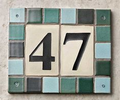 This house numbers plaque can be customized by choosing from 22 different tile colors for the border. Cost: about $120 as shown; Clayworks. | Photo: Andrew McCaul | thisoldhouse.com