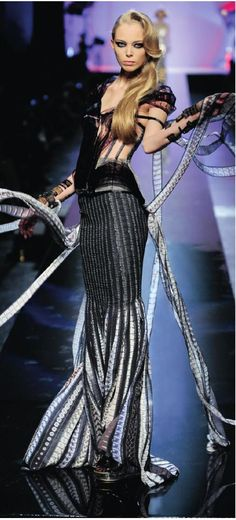"""Movie Stars (or Cinema) collection, """"Étoiles et toiles"""" gown Haute couture fall/winter Acetate-film-covered corset edged with black satin, articulated shoulders and hips, georgette film-stock-print sheath skirt © Patrice Stable / Jean Paul Gaultier. Jean Paul Gaultier, Crossover, Couture Fashion, Fashion Show, High Fashion, Dark Fashion, Female Fashion, Fashion Trends, Unique Fashion"""