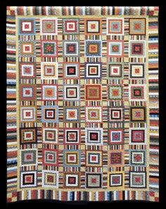 Cabin Tracks for Tommy, was pieced by Barbara Treese and quilted by Jane Plisg