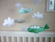 The mobile can be defined as moving sculpture. Early mobiles did not necessarily move, as do most crib mobiles today. The modern crib mobile is… Baby Cot Mobiles, Baby Cribs, Airplane Mobile, Felt Mobile, Baby E, Nursery Room, Felt Crafts, New Baby Products, Crafty