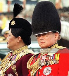 This picture taken 03 December 1996 shows Thai King Bhumibol Adulyadej (R) and Queen Sirikit sit together during a review of the Thai troops in Bangkok. Thailand will celebrate their King and Queen's 50th wedding anniversary 28 April 2000. AFP PHOTO/Pornchai KITTIWONGSAKUL