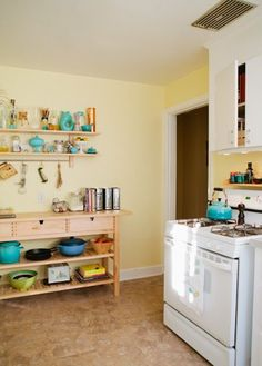 Ikea Norden sideboard as kitchen storage (love the turquoise accents)