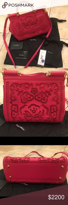 Dolce & Gabbana laser cut bag Hot pink laser cut Dolce & Gabbana bag with crossbody strap. I have the original tag from Saks and authenticity card in one of the photos. I only used it a couple of times. This bag is gorgeous!! Dolce & Gabbana Bags Crossbody Bags