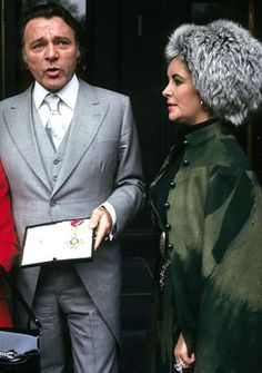 Richard Burton and Elizabeth Taylor - arriving at the Dorchester hotel, with Richard displaying his OBE (Order of the British Empire), Londo...