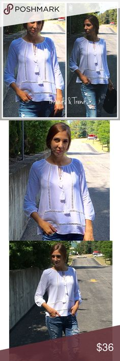 White Crotchet Inset Peasant Blouse WHITE CROCHET INSET PEASANT BLOUSE  PRODUCT DESCRIPTION  • crochet inset detailing throughout • tassel tie accented neckline • 3/4 sleeves • relaxed, easy fit • light weight, breathable material  Material Content: Tops Blouses