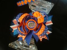 Check out this item in my Etsy shop https://www.etsy.com/listing/480785213/florida-gators-hair-bow-and-headband-set