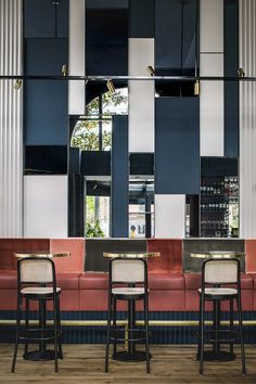 Café Weldeck, Amsterdam. Framework studio, classic rattan chairs by Thonet, wall lamps by Allied Maker.