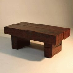 dark stained coffee table made from recovered railway sleepers