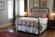 Wrought iron bed frame and nice color scheme