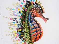 This fun whimsical seahorse is made of fiberglass from my original clay sculpture and handpainted in permanent acrylis. The fun part is all the embellishments, colored wires and beads really give this guy an artistic character like no other. Hes been sprayed with a poly sealer and has a wire loop on his back for easy hanging. Perfect for your bathroom or coastal decor.   He is finished and will ship the next day after purchase. The seahorse you see in these pictures is the actual sculpture…