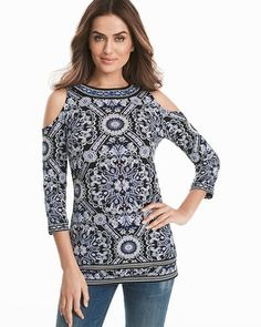 "Our latest matte jersey tunic gets a trendy update with exposed shoulders and bold medallion and border prints. This is perfect to wear with denim or black ankle pants.  Cold-shoulder matte jersey medallion printed tunic in white with admiral Approx. 30"" from shoulder Polyester/spandex. Machine wash cold. Imported"